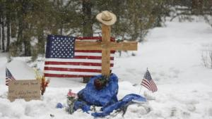 "A memorial for Robert ""LaVoy"" Finicum is seen where he was shot and killed by law enforcement on a highway north of Burns, Oregon January 30, 2016. Four armed anti-government protesters held their ground at the remote Malheur National Wildlife Refuge in Oregon on Saturday, two days after the FBI released a video of the fatal shooting of one of the group's spokesmen during a traffic stop. REUTERS/Jim Urquhart"
