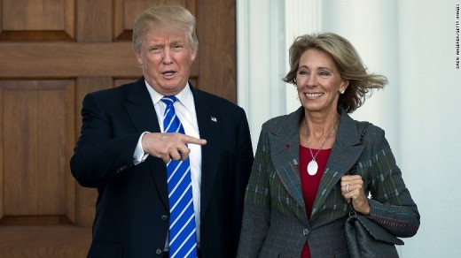President Donald Trump and Education Secretary Betsy DeVos
